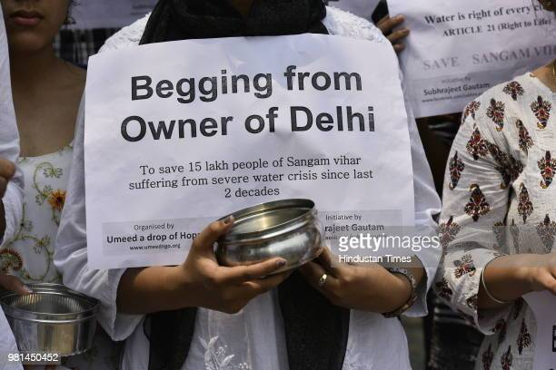 College students participate in a protest to demand water supply for residents of Sangam Vihar at Civil Lines on June 22 2018 in New Delhi India