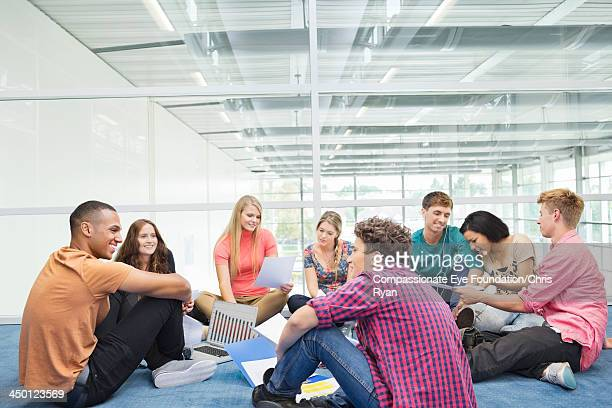 College students relaxing in hallway
