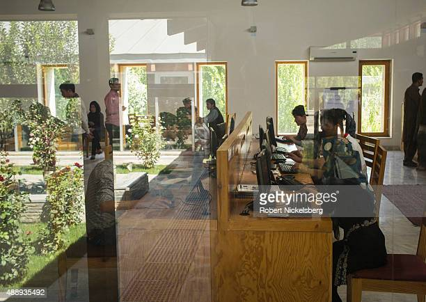 College students search the internet August 31, 2015 on computers at the Afghanistan Center at Kabul University in Kabul, Afghanistan.