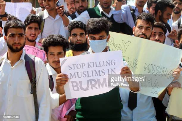 College Students shout slogans as they protest against the persecution of Myanmar's Rohingya Muslim minority in Anantnag Indian controlled Kashmir