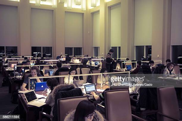 College students study at night in the reading room of the Brody Learning Commons, a study space and library on the Homewood campus of the Johns...
