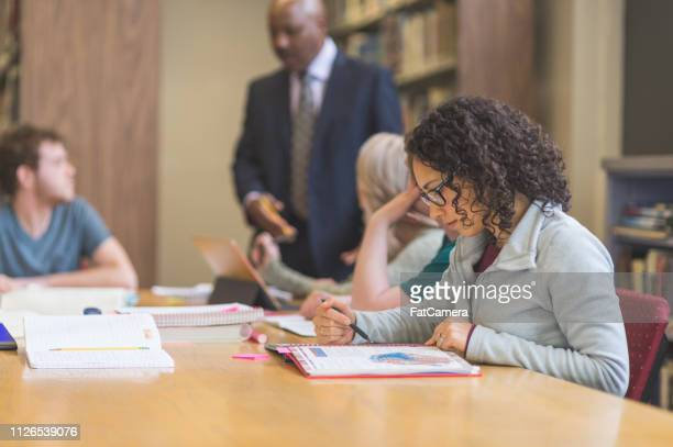 college students studying in the library - master's degree stock pictures, royalty-free photos & images