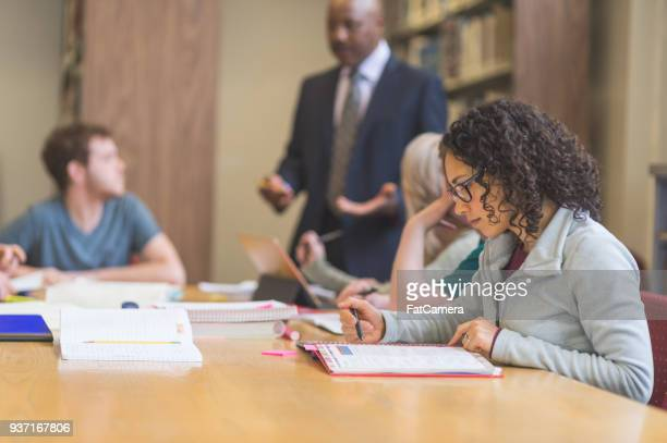 college students studying in university library - master's degree stock pictures, royalty-free photos & images