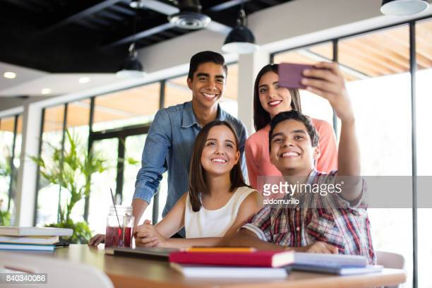 College students taking selfie at the cafeteria