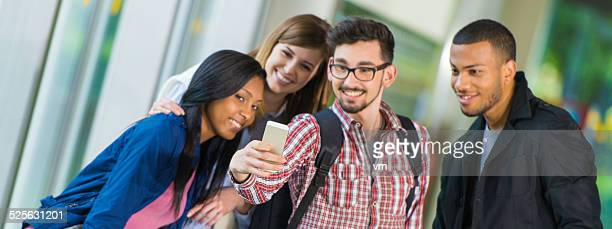 College Students Taking Selfie in the Corridor