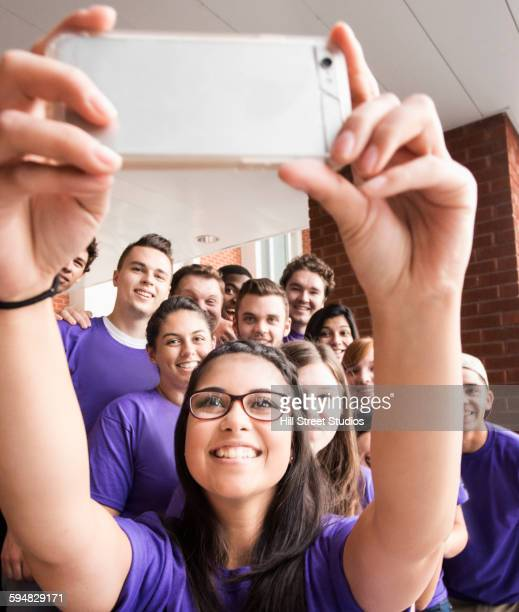 College students taking selfie outside dormitory
