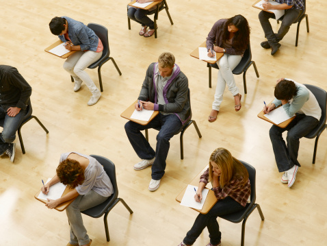 College students taking test in classroom - gettyimageskorea