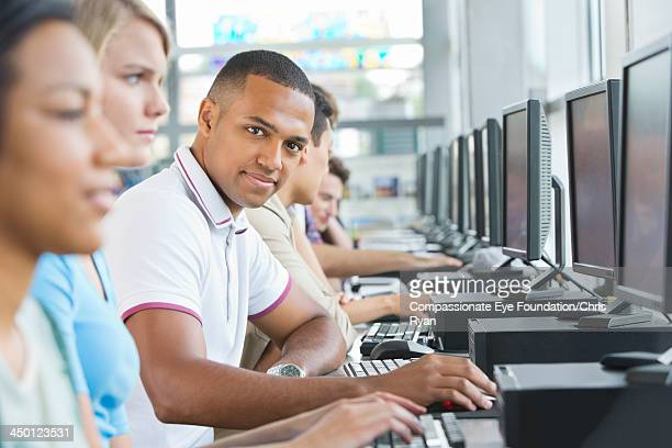 College students using computers in classroom