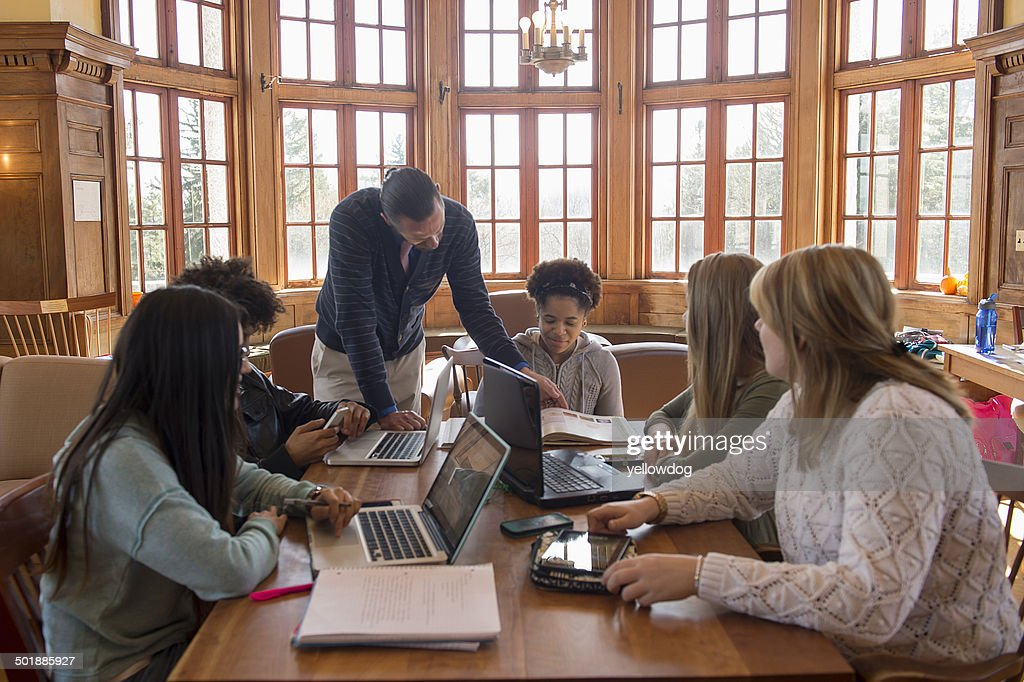 College students using laptops : Stock Photo