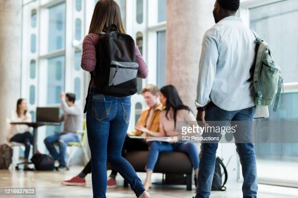 college students walking to class - community college stock pictures, royalty-free photos & images