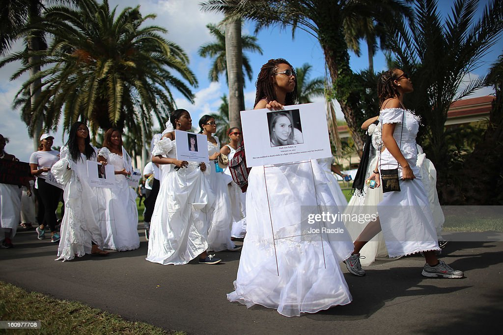 College students wear wedding gowns as they participate in the College Bride's Walk from Barry University on February 8, 2013 in Miami Shores, Florida. The students from area colleges walked six miles to raise awareness of the issue of domestic violence.