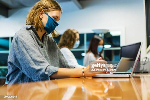 college students wearing face masks working together in computer lab setting - college student stock pictures, royalty-free photos & images