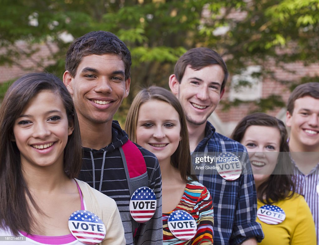 College students wearing 'vote' buttons on campus : Stock Photo