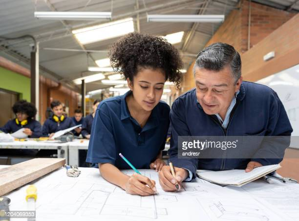 college students working together on a design project together - trainee stock pictures, royalty-free photos & images