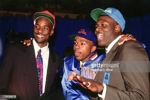 College teammates at UNLV Larry Johnson of the Charlotte Hornets Stacey Augmon of the Atlanta Hawks and Greg Anthony of the New York Knicks pose for...