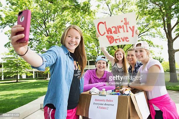 college volunteer taking a selfie with friends