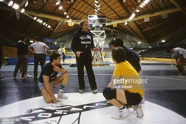Villanova head coach John du Pont instructs wrestlers during practice at John Eleuthere du Pont Pavilion Villanova PA CREDIT Lane Stewart