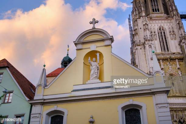 collegiate church of sankt johann against cloudy sky, regensburg, upper palatinate, bavaria, germany - レーゲンスブルク ストックフォトと画像