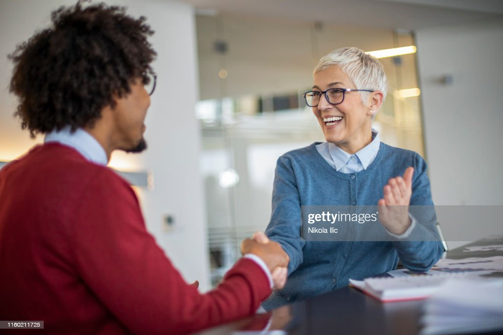 Collegues greeting at meeting : Stock Photo