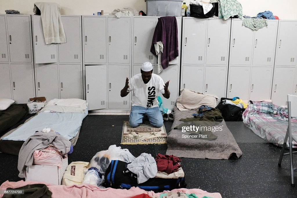 Collen Harris, a practicing Muslim and a displaced resident from the island of Barbuda, prays inside a shelter at a cricket stadium on December 7, 2017 in St John's, Antiqua. Barbuda, which covers only 62 square miles, was nearly leveled when Hurricane Irma made landfall with 185mph winds on the night of September 6. Only two days later, fearing Barbuda would be hit again by Hurricane Jose, the prime minister ordered an evacuation of all 1,800 residents of the island. Most are now still in shelters scattered around Barbuda's much larger sister island Antigua.