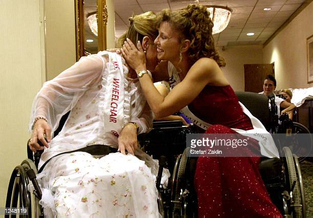 Collen Macort Ms Wheelchair Florida hugs Jodi Washnock Ms Wheelchair Colorado before the final part of this year's Ms Wheelchair America competition...