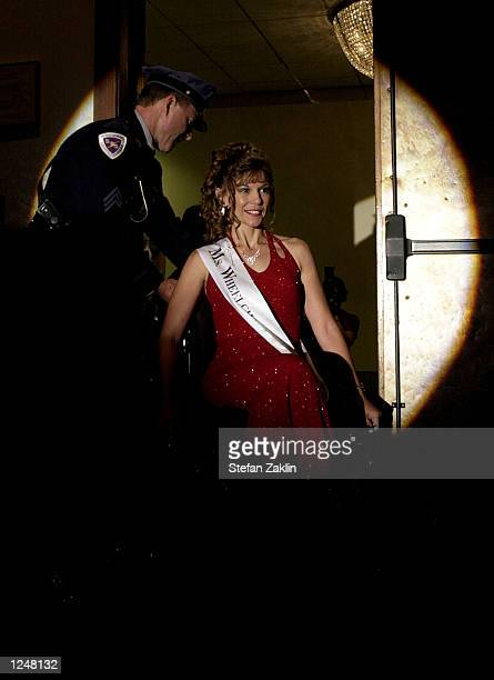 Collen Macort Ms Wheelchair Florida makes her entrance for the final part of this year's Ms Wheelchair America competition on August 3 2002 in...