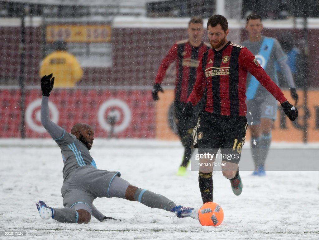 Collen Warner #26 of Minnesota United FC slides to get the ball away from Chris McCann #16 of Atlanta United FC during the second half of the match on March 12, 2017 at TCF Bank Stadium in Minneapolis, Minnesota. Atlanta defeated Minnesota 6-1.