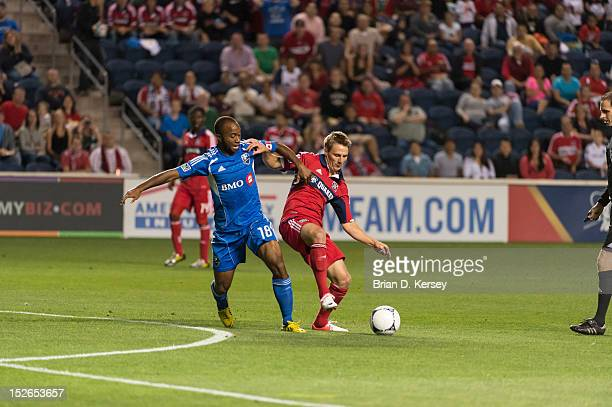 Collen Warner of Montreal Impact and Chris Rolfe of Chicago Fire go for the ball at Toyota Park on September 15 2012 in Bridgeview Illinois The Fire...