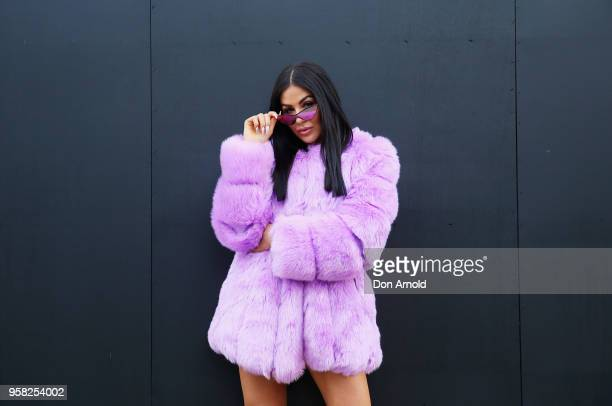 Collette Emily wears jacket by Fashion shoes by Simmi and sunglasses by Le Specs during MercedesBenz Fashion Week Resort 19 Collections at...