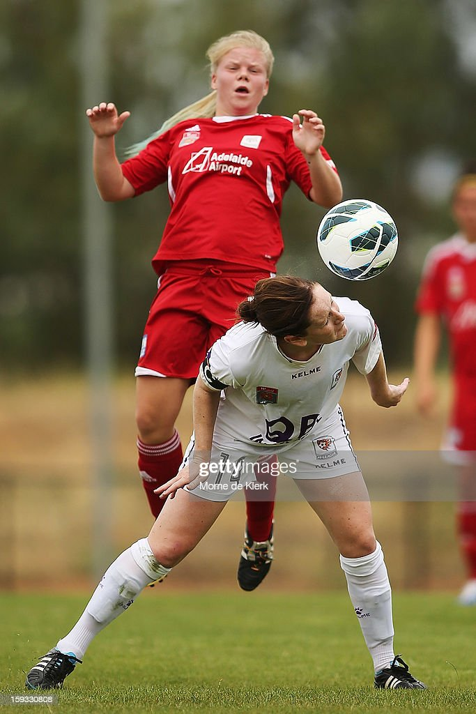 Collette McCallum of Perth wins the ball in front of Jessica Waterhouse (R) of Adelaide during the round 12 W-League match between Adelaide United and the Perth Glory at Burton Park on January 12, 2013 in Adelaide, Australia.