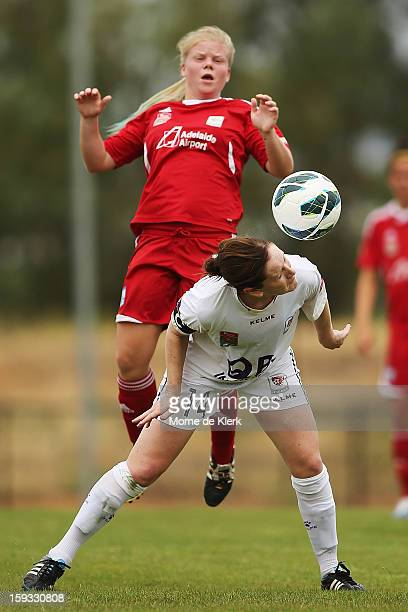 Collette McCallum of Perth wins the ball in front of Jessica Waterhouse of Adelaide during the round 12 WLeague match between Adelaide United and the...