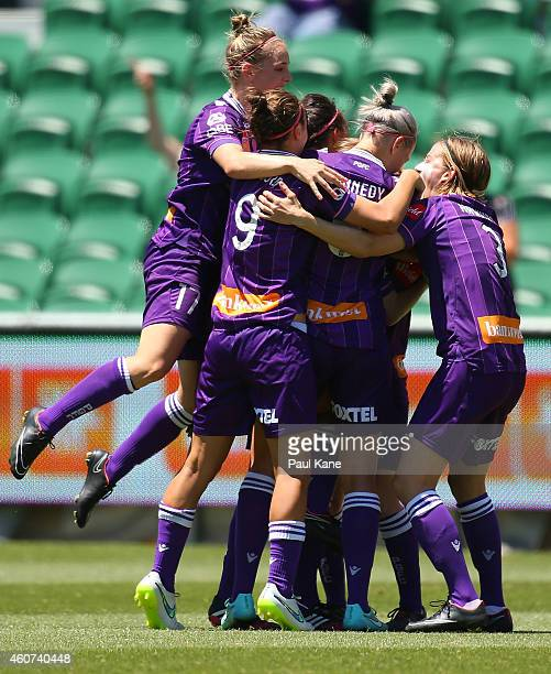 Collette McCallum of the Glory is congratulated by team mates after scoring a goal during the WLeague Grand Final match between Perth and Canberra at...