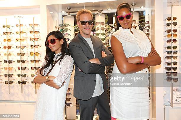 Collien UlmenFernandes Jahn Hahn and Cassandra Steen during the late night shopping at Designer Outlet Soltau on August 5 2016 in Soltau Germany