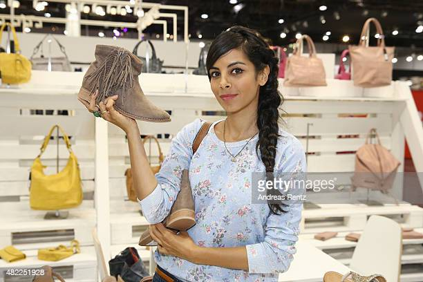 Collien UlmenFernandes poses at a shoe booth during the first day of the GDS Global Destination for Shoes Accessories tradeshow on July 29 2015 in...
