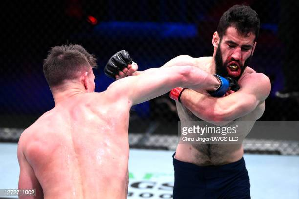 Collin Anglin punches Muhammad Naimov in their featherweight bout during week seven of Dana White's Contender Series season four at UFC APEX on...