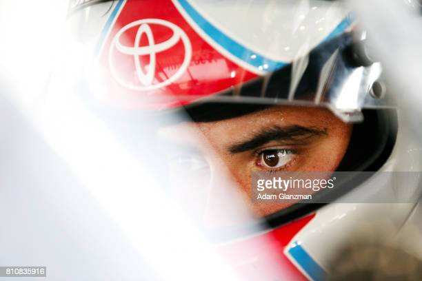 Collin Cabre driver of the UTI/NTI Toyota looks on from his car in the garage during practice before the NASCAR KN Pro Series East at Thompson...