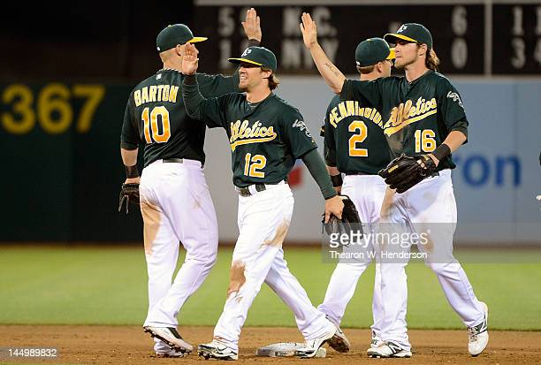 Collin Cowgill Daric Barton Cliff Pennington and Josh Reddick of the Oakland Athletics celebrate defeating the Los Angeles Angels of Anaheim 2 to 1...