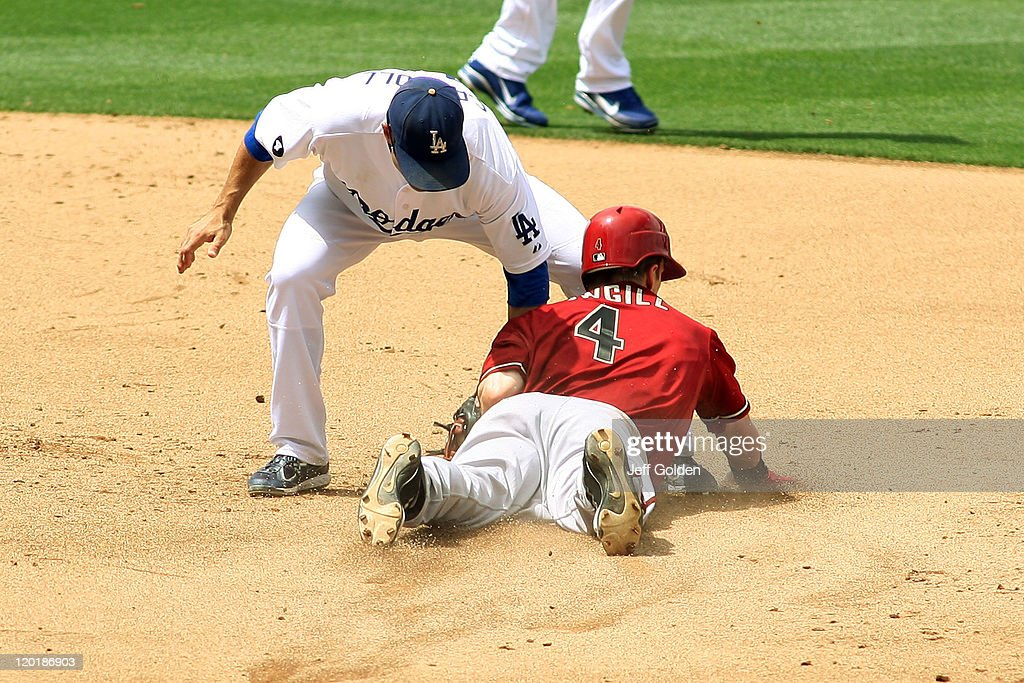 Collin Cowgill #4 of the Arizona Diamondbacks steals second base ahead of the tag by Jamey Carroll #14 of the Los Angeles Dodgers in the fourth inning of the game at Dodger Stadium on July 31, 2011 in Los Angeles, California. The stolen base was Cowgill's second of his career. Photo by Jeff Golden/Getty Images)