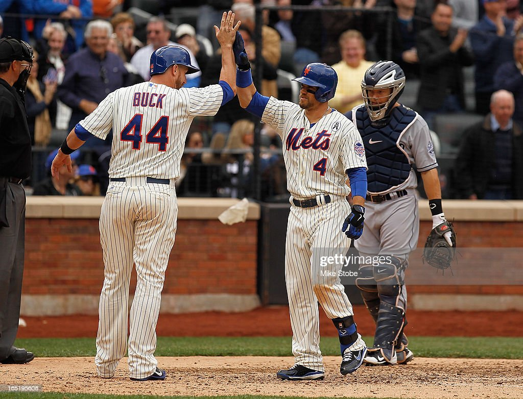 Collin Cowgill #4 of the New York Mets is greeted by John Buck #44 after hitting a grand slam in the seventh inning against the San Diego Padres on opening day at Citi Field on April 1, 2013 in the Flushing neighborhood of the Queens borough of New York City.