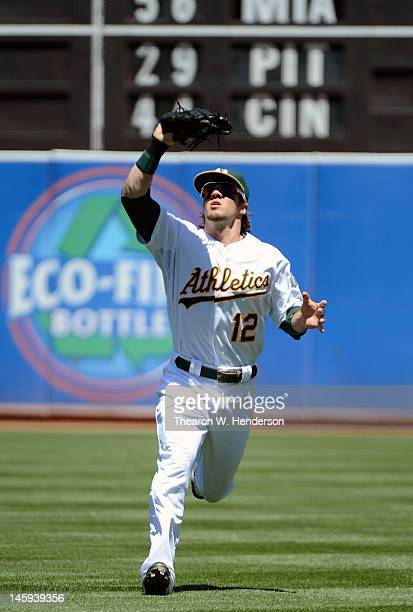 Collin Cowgill of the Oakland Athletics comes in to catch a short fly ball to right field against the Texas Rangers at Oco Coliseum on June 7 2012 in...