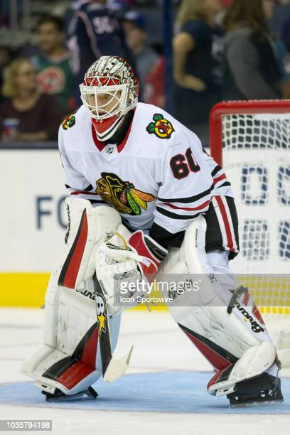 Collin Delia of the Chicago Blackhawks looks on in the third period of a game between the Columbus Blue Jackets and the Chicago Blackhawks on...