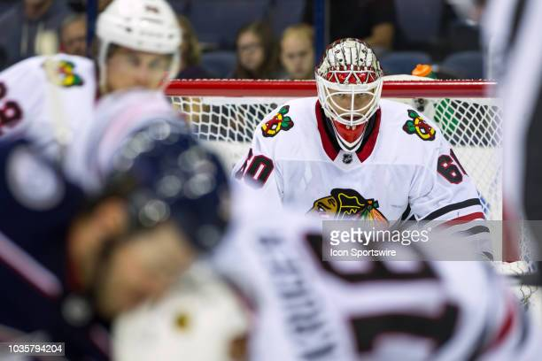Collin Delia of the Chicago Blackhawks watches a faceoff in the third period of a game between the Columbus Blue Jackets and the Chicago Blackhawks...