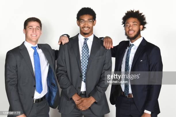 Collin Gillespie, Jermaine Samuels and Justin Moore of the Villanova Wildcats pose for a photo during the Big East Media Day at Madison Square Garden...