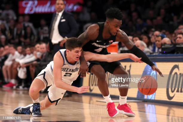 Collin Gillespie of the Villanova Wildcats competes for the ball with Maliek White of the Providence Friars in the second half during the...