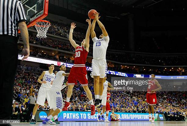 Collin Hartman of the Indiana Hoosiers and Isaiah Briscoe of the Kentucky Wildcats vie for a rebound in the second half during the second round of...