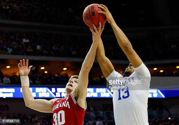 Collin Hartman of the Indiana Hoosiers rebounds against Isaiah Briscoe of the Kentucky Wildcats in the second half during the second round of the...