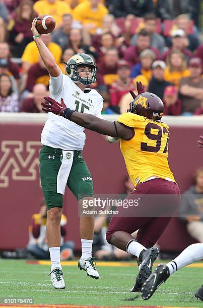 Collin Hill of the Colorado State Rams throws the ball while Scott Ekpe of the Minnesota Golden Gophers applies pressure in the fourth quarter...