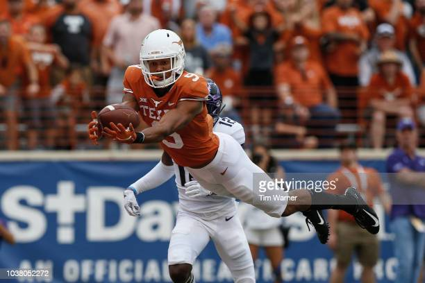 Collin Johnson of the Texas Longhorns catches a pass for a touchdown in the third quarter defended by Jeff Gladney of the TCU Horned Frogs at Darrell...
