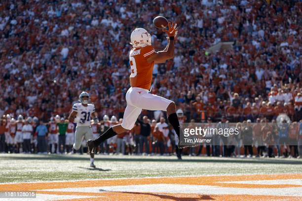 Collin Johnson of the Texas Longhorns catches a pass for a touchdown in the first half against the Kansas State Wildcats at Darrell K Royal-Texas...