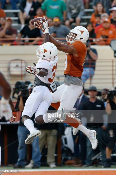 Collin Johnson of the Texas Longhorns catches a pass for a touchdown in the first half defended by Kobe Boyce during the OrangeWhite Spring Game at...